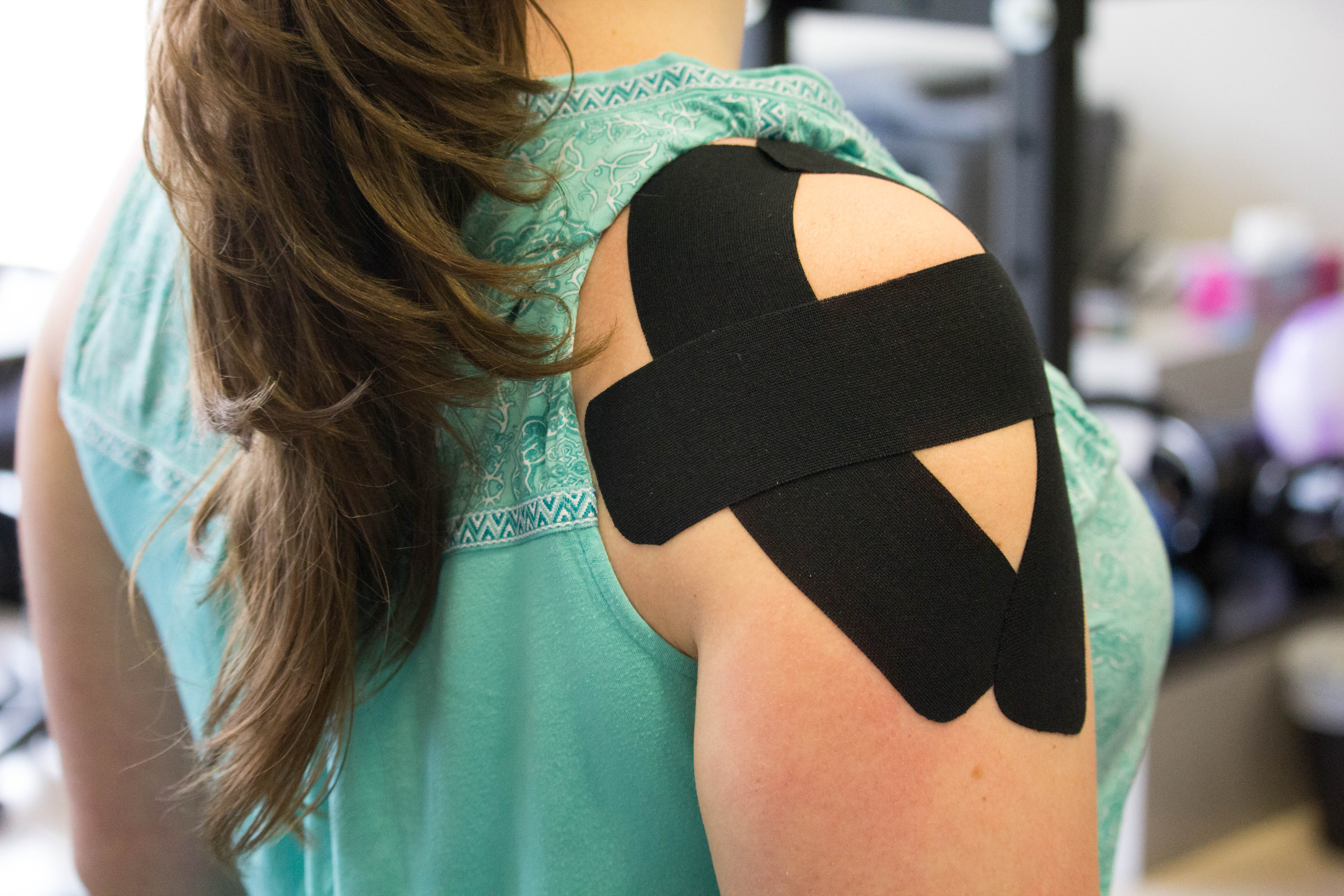 athletic taping on shoulder